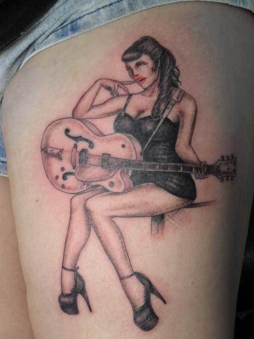 woman-playing-on-guitar-tattoo-on-thigh