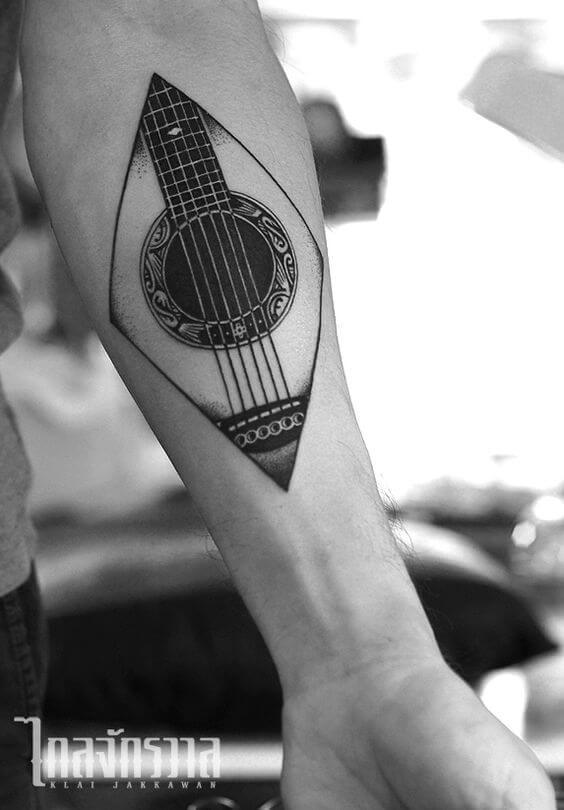 ad4ebde6f2cf8 27 Guitar Tattoos You'll Either Love or Hate